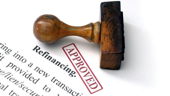 Photo illustration: Refinancing debts