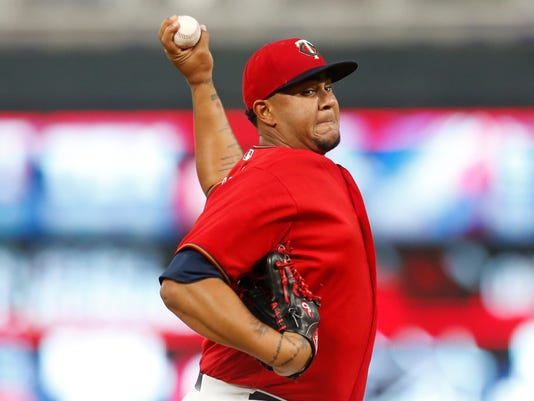 Minnesota Twins pitcher Adalberto Mejia throws against the Chicago White Sox during the first inning of a baseball game Friday, April 14, 2017, in Minneapolis. (AP Photo/Jim Mone)