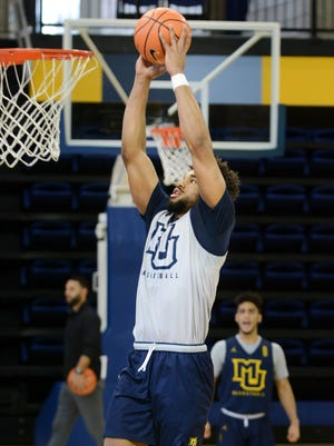 Marquette forward Ed Morrow, who is sitting out this season as a transfer, dunks during a December practice at the Al McGuire Center.