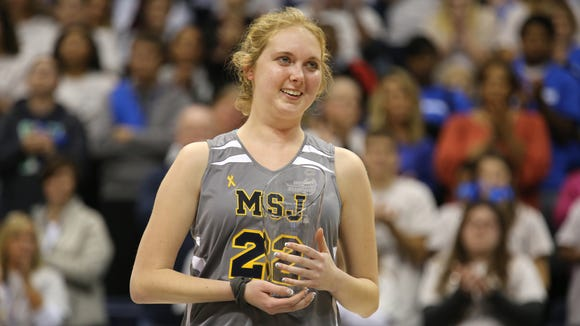 Lauren Hill, 19, a freshman at Mount St. Joseph University, receives the Wilma Rudolph Student Athlete Achievement Award after her first college basketball game.