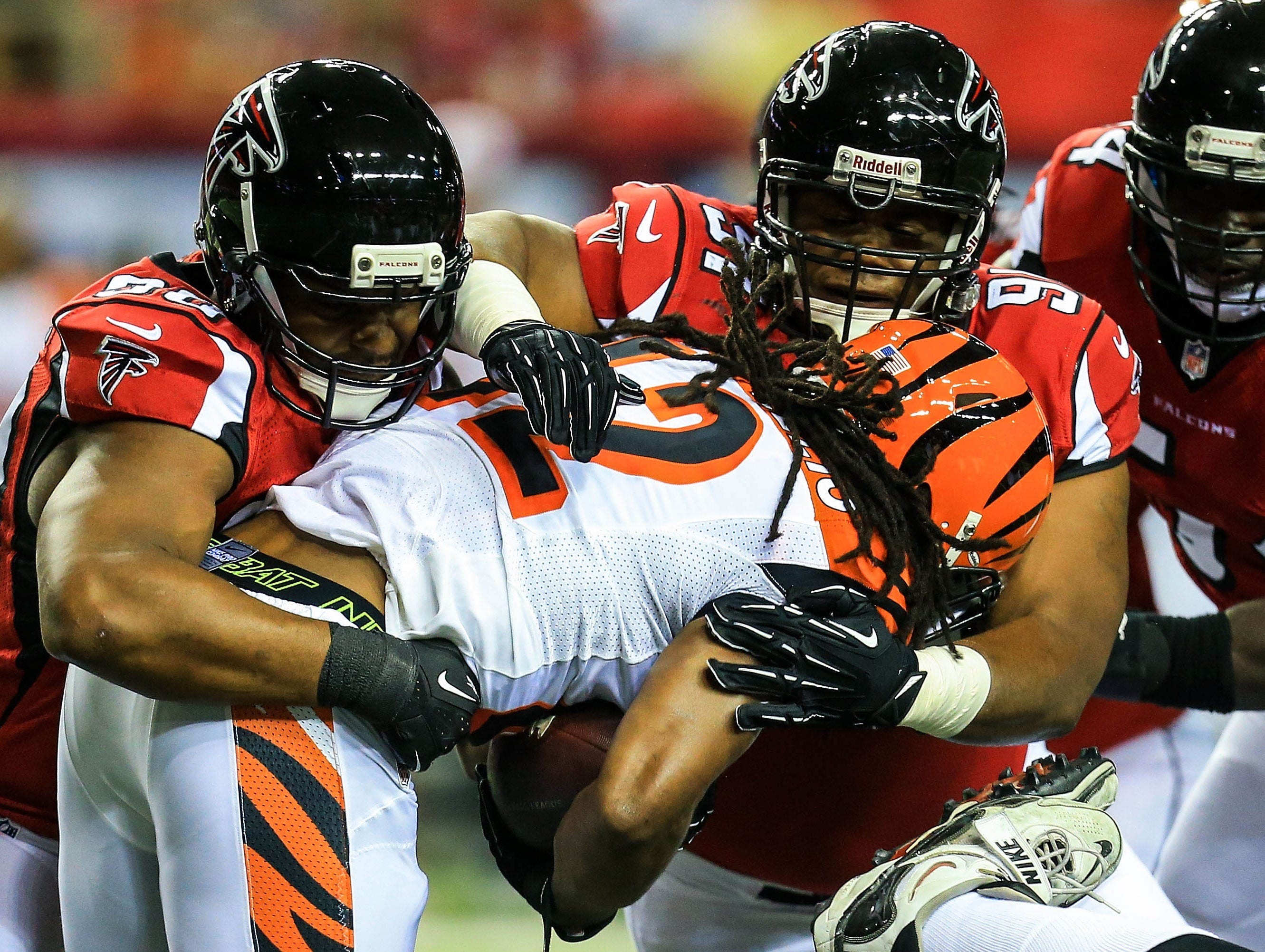 Atlanta Falcons defensive end Osi Umenyiora (90) and nose tackle Travian Robertson (92) tackle Cincinnati Bengals running back BenJarvus Green-Ellis (42) in the first half at the Georgia Dome.