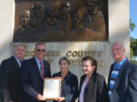 Maria Maio-Messano, New Jersey Field Office Director for the U.S. Department of Housing and Urban Development (HUD), center, presents certification of the county's achievement of effectively ending veterans' homelessness in the county to (from left) Middlesex County Freeholder Charles Kenny, Freeholder Director Ronald G. Rios, Freeholder Blanquita B. Valenti and Freeholder Charles E. Tomaro.
