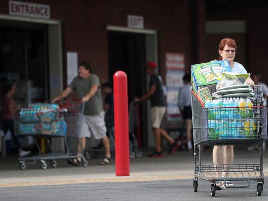 Margie Wright walks out of Costco with a full cart