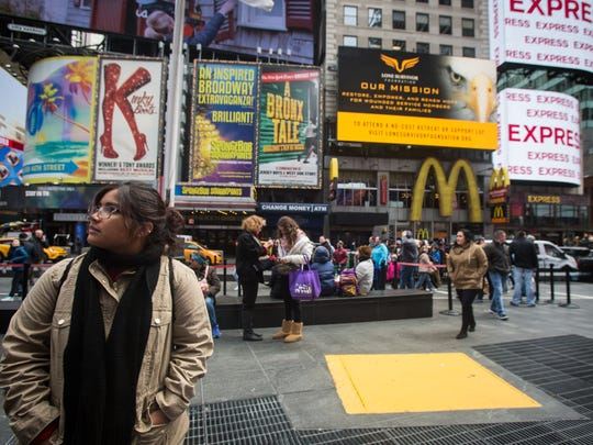 Palmetto Ridge sophomore Bianca Galzan looks at the billboards in Times Square Saturday, April 7, 2018. Palmetto Ridge and Gulf Coast high school choirs are in New York to perform at Carnegie Hall.