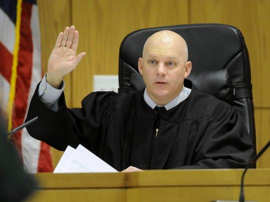 Circuit Judge Gary Bergosh swears in a defendant during