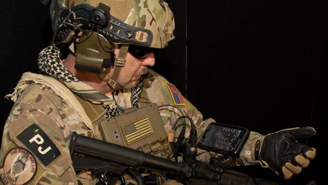 Chief Master Sgt. Robert Bean, an Air Force pararescue jumper, demonstrates how the Battlefield Assisted Trauma Distributed Observation Kit can be worn on the wrist, providing awareness of the health status of multiple patients. Developing BATDOK required Air Force medical researchers to embed with pararescue jumpers on live missions to ensure the tool met the rigorous standards required by combat Airmen.