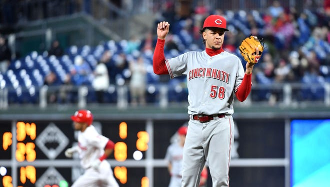 Cincinnati Reds starting pitcher Luis Castillo (58) waits for a new baseball after allowing home run by Philadelphia Phillies shortstop J.P. Crawford (2) during the second inning at Citizens Bank Park.