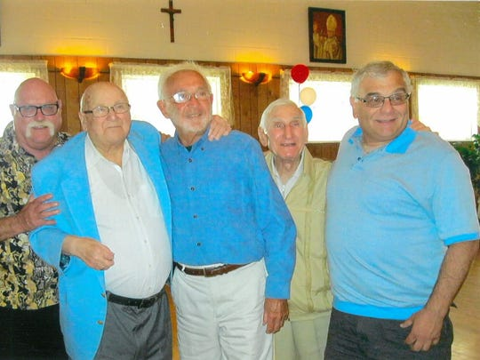 Joe Yanuzzi (second from right) stands among a group of retired baseball umpires.