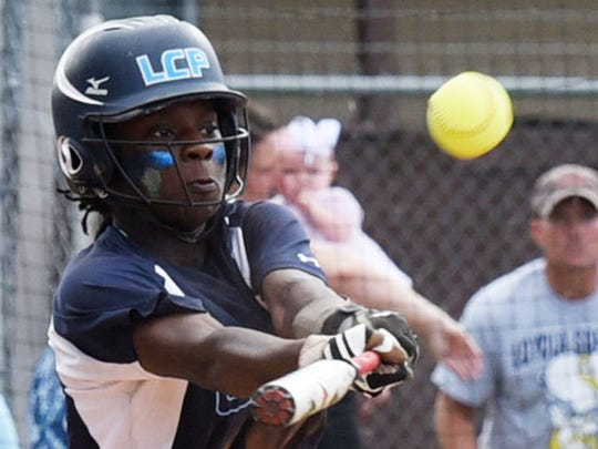 Loyola's K. Moore hits the ball during their game against Vanderbilt Catholic in the LHSAA Division II state softball playoff game Friday afternoon.