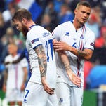 France's Olivier Giroud celebrates after scoring his side's fifth goal during France's victory over Iceland at the European Championships.