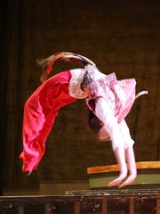 Kereil Kindle tumbles across stage as the king's jester