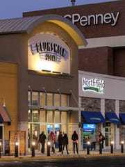 Shoppers enter Brunswick Square Mall at 6:39 A.M. on