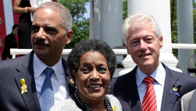 Attorney General Eric Holder; Myrlie Evers-Williams, the widow of slain civil rights activist Medgar Evers; and former president Bill Clinton observe the 50th anniversary remembrance ceremony of Evers' death on June 5, 2013, at Arlington National Cemetery in Arlington, Va.