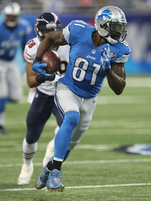 Detroit Lions Calvin Johnson catches a  pass during second quarter action against the Chicago Bears Sunday, October 18, 2015 at Ford Field in Detroit.