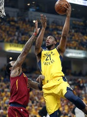 Indiana Pacers forward Thaddeus Young (21) shoots over Cleveland Cavaliers guard JR Smith (5) during the first half of Game 6 at Bankers Life Fieldhouse on Friday, April 27, 2018.