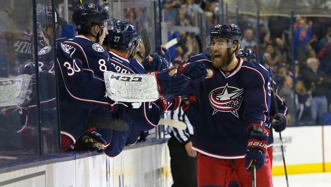 Columbus Blue Jackets defenseman David Savard (58) celebrates a goal against the Montreal Canadiens during the first period at Nationwide Arena.