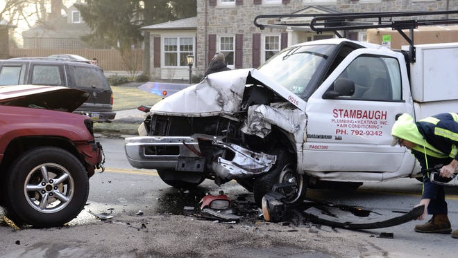 Clean up for a head-on collision at Harlan and East Market Street in Springettsbury Township. Planned improvements along the East Market Street corridor are intended to address crashes.