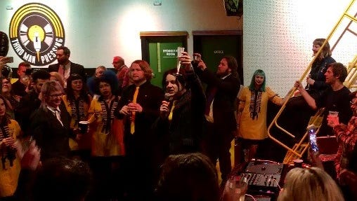 Jack White holds up a glass of champagne as he toasts the opening of the new Third Man Pressing plant in the Cass Corridor on Friday.
