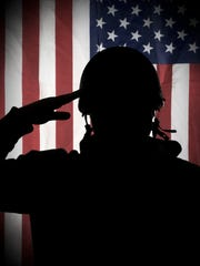 Silhouette of American (USA) soldier saluting to USA