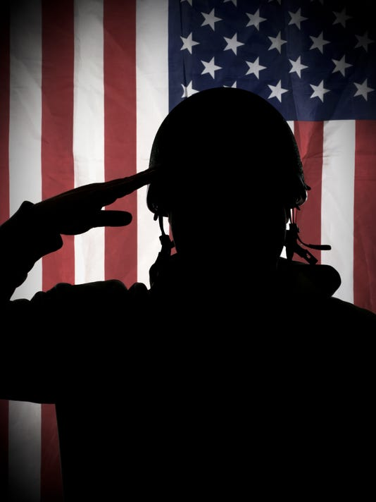 American (USA) soldier saluting to USA flag