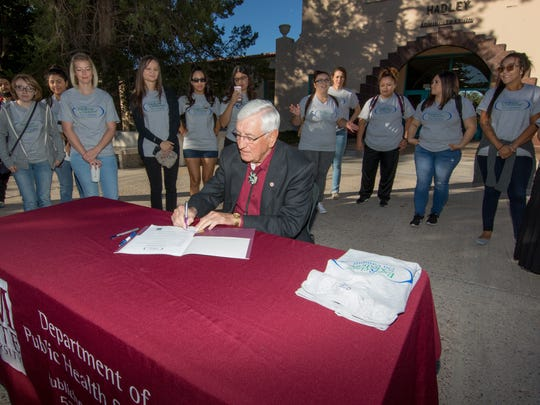 NMSU President Garrey Carruthers signs a proclamation declaring October as Exercise is Medicine on Campus month before the President's Walk held on Wednesday, October 19, 2016.