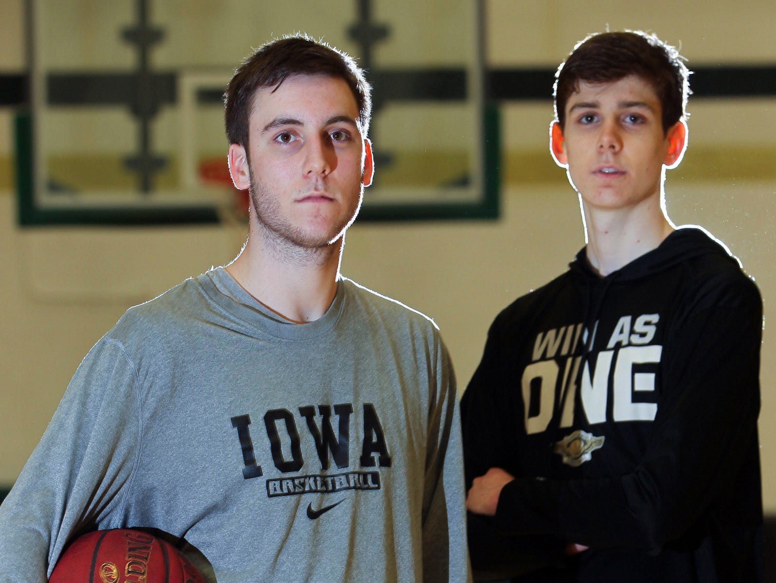 West High's Connor and Patrick McCaffery pose for a photo after practice on Monday, March 6, 2017.