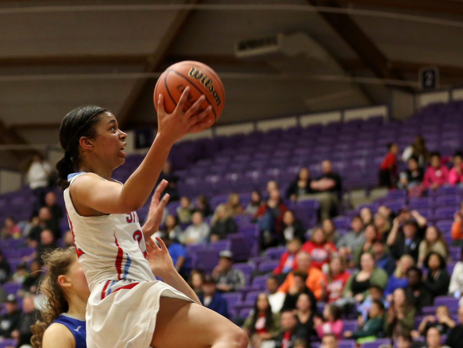 South Salem's Evina Westbrook (22) goes for two points during the second half of the Grant vs. South Salem girl's basketball game to determine third place in the OSAA Class 6A State Championships at the University of Portland on Saturday, March 11, 2017. South Salem won the game 58-53.