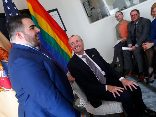 Democratic Gubernatorial candidate Phil Murphy is introduced by Garden State Equality Executive Director Christian Fuscarino (left) during a roundtable discussion at the group's office in Asbury Park Thursday, April 13, 2017.