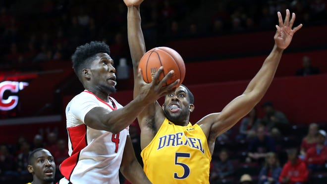 Rutgers forward Jonathan Laurent (4) takes a shot past Drexel forward Austin Williams (5) during the first half of a NCAA college basketball game, Sunday, Nov. 13, 2016, in Piscataway, N.J. (AP Photo/Mel Evans)