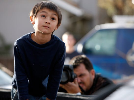 Falcon Heene, 6, sits in the box of his family's pickup