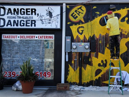The black wall outside Danger, Danger in Cape Coral was the perfect spot for Peelander-Yellow to paint a mural. The mural faces the parking lot on SW 47 Terrace.