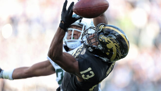 Sep 9, 2017; East Lansing, MI, USA;Western Michigan Broncos wide receiver Keishawn Watson (13) attempts to make a catch against the Michigan State Spartans  during the second half of a game at Spartan Stadium. Mandatory Credit: Mike Carter-USA TODAY Sports ORG XMIT: USATSI-359544 ORIG FILE ID:  20170909_jla_bc2_229.jpg