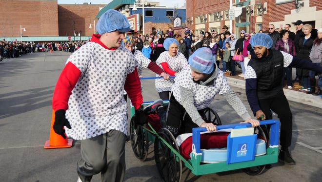 Members of the Orthopedic Associates Blue team turn their racing bed  at the Port Huron Chilly Fest on Saturday, Jan. 27, 2018.
