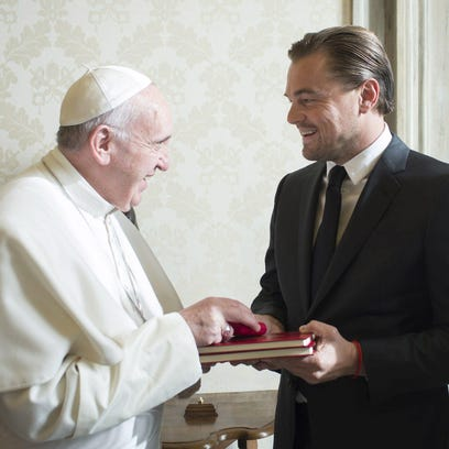Pope Francis, left, and actor Leonardo Di Caprio during a private audience at the Vatican on Thursday.