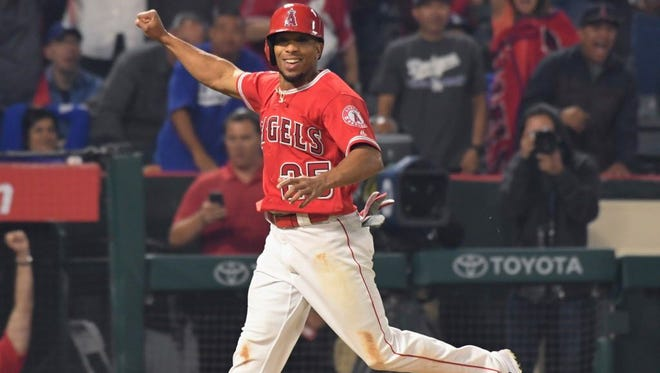 Los Angeles Angels left fielder Ben Revere (25) heads to home to score the winning run in the bottom of the ninth inning against the Los Angeles Dodgers at Angel Stadium of Anaheim. Revere scored on a wild pitch third strike and a throwing error.