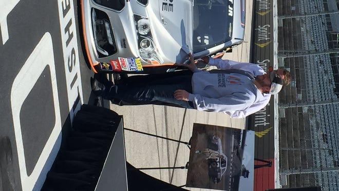 Dale Earnhardt Jr. unveils his Darlington throwback paint scheme honoring Buddy Baker Wednesday.