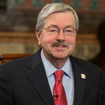 Iowa Gov. Terry Branstad said Monday that the Iowa Democratic Party should consider evaluating its caucus processes.