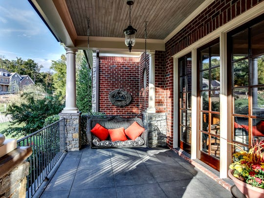 The front porch spans the home, offering wonderful views.