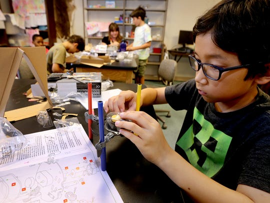 Serik Bilbro builds a model at Camp STEM at MTSU>