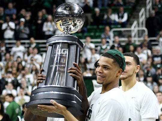 Michigan State's Miles Bridges holds the BIG 10 Conference championship trophy after the game on Tuesday, Feb. 20, 2018, at the Breslin Center in East Lansing. The Spartans beat Illinois 81-61.