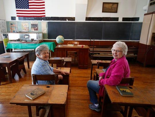 Judy McClymond and Genie Hansen pose in the Hoosier
