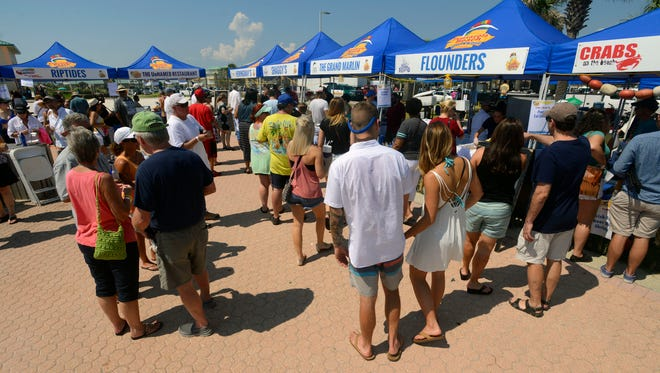 Eateries dish out food Saturday during Taste of the Beach at Pensacola Beach. Along with seventeen Pensacola Beach restaurants offering servings of some of there signature dishes, there was music, cooking demonstrations and cook-offs.