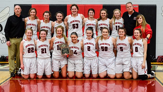 The 2019-20 Chillicothe High School basketball Lady Hornets were both Class 3 district champions and state-tournament participants and Midland Empire Conference tri-champions. Seen after winning the district title on their home court, team members included, from left: Front - Selby Miller, Jordan Hibner, Hunter Keithley, Josey Reeter, Haley Kidd, Montana Plattner, Ella Leamer, Kaylee Munson; Back - head coach Darren Smith, Essie Hicks, Lucy Reeter, Jessica Reeter, Brooke Horton, Ellie Barnett, Sophia Luetticke, Clara Leamer, and assistant coaches Terry McKiddy and Jennifer Dickson.