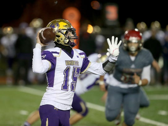 North Kitsap quarterback Andrew Blackmore looks to