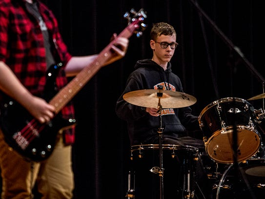 Heath freshman, Adian Schaffer, plays on stage at Heath