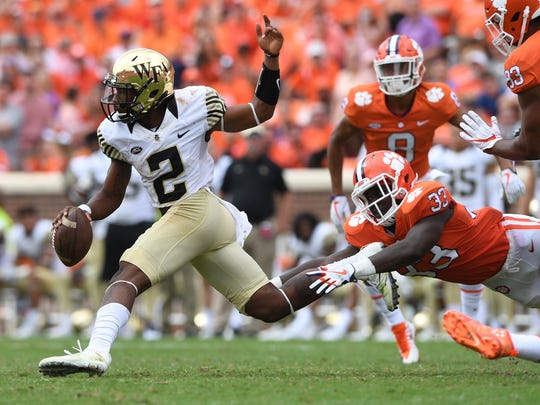 Wake Forest quarterback Kendall Hinton (2) carries past Clemson linebacker J.D. Davis (33) during the 4th quarter on Saturday, October 7, 2017 at Clemson's Memorial Stadium.