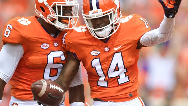 Clemson Denzel Johnson (14) celebrates with linebacker Dorian O'Daniel (6) after recovering a fumble by SC State wide receiver Ahmaad Harris (1) in the end zone for a TD during the 1st quarter on Saturday, September 17, 2016 at Clemson's Memorial Stadium.