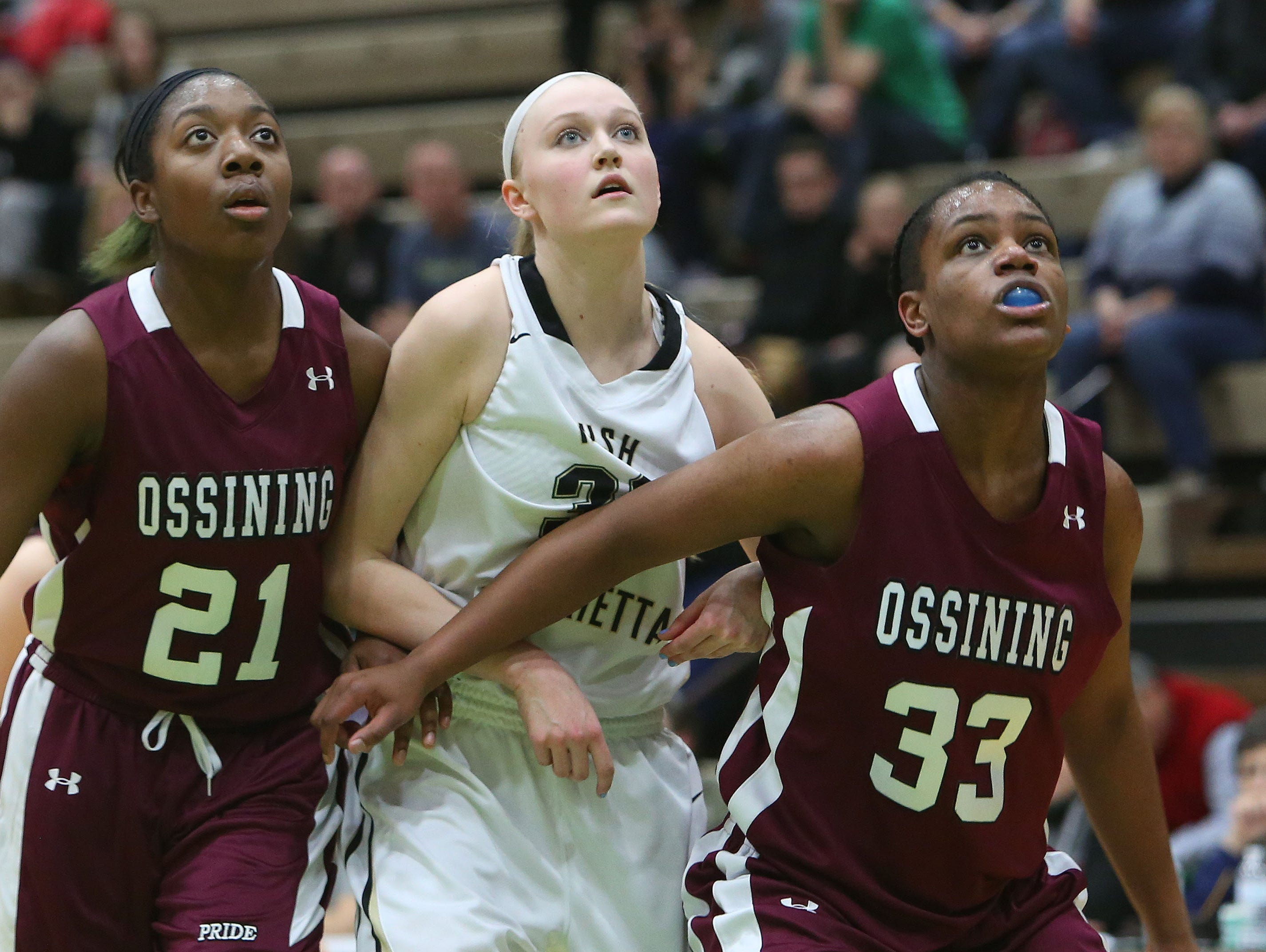 Ossining's Shadeen Samuels (21) and Jalay Knowles (33) box out against Rush Henrietta in the girls state Class AA championship game at Hudson Valley Community College in Troy, N.Y. March 21, 2015.