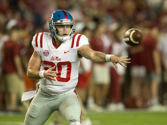 In this file photo, Ole Miss QB Shea Patterson pitches the ball during a game against Alabama. He finished his career with the Michigan football program.