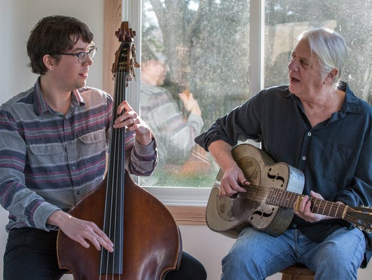 Grayson English, left, performs with his father, Chris,